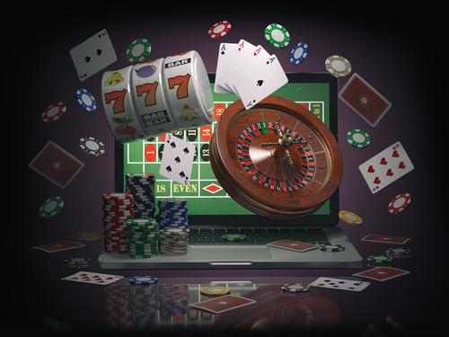 illustration en 3d d'un ordinateur et d'une multitude de jeux de casino
